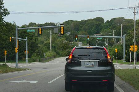 Narragansett, Rhode Island-September 2017: A car travels on the road in Narragansett.