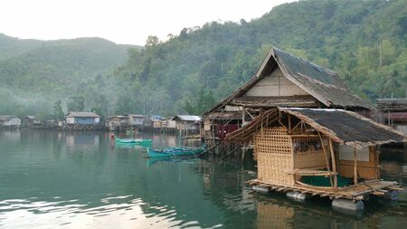 Banay-Banay, Davao Oriental, Philippines - March 2016: Houses on stilts in a fishing village in Puntalinao, Davao Oriental 스톡 콘텐츠