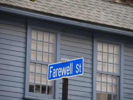 Windows of an old building with a sign of Farewell Street in Newport, Rhode Island.