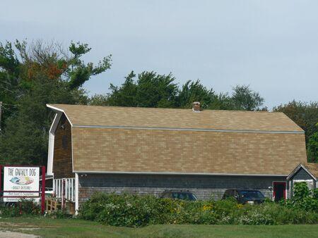 Narragansett, Rhode Island-September 2017: Side view of the Gnarly Dog, a dog day care center in Narragansett.