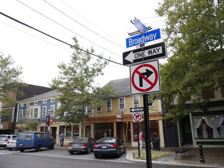 Newport, Rhode Island-September 2017: Row of shops and stores and cars parked at Broadway Street, Newport.
