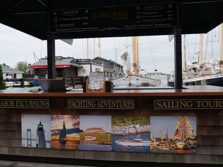 Newport, Rhode Island-September 2017: Close up of ticket counter for sailing, yachting, cruises and excursions at the Wharf area.