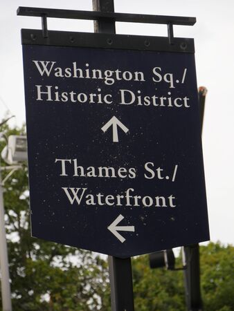 Newport, Rhode Island-September 2017: Close up of a roadside sign with arrows direction to the Washington Square Historic District, Thames street and the Waterfront.