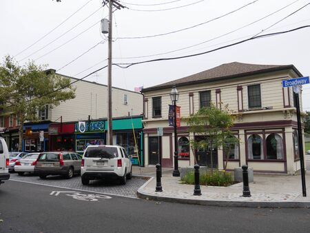 Newport, Rhode Island-September 2017: Shops with vehicles parked infront in Broadway Street, Newport
