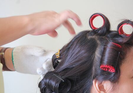 Hair of a bride in rollers during the wedding preparation