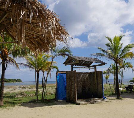 Open shower installed at a beach in Roatan, Honduras.