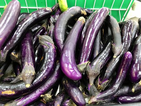 Pile of purple eggplants at the fresh produce section in a grocery store. Stock fotó