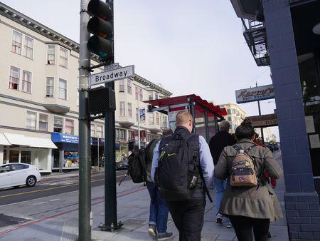 San Francisco, California-July 2018: People walking on the streetside in Broadway, San Francisco.