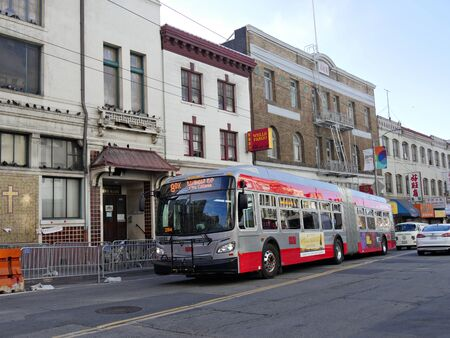 San Francisco, California-July 2018: A shuttle bus is parked infront of buildings near Chinatown, San Francisco.