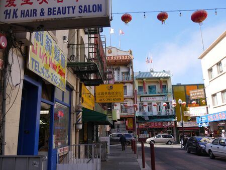 San Francisco, California-July 2018: Colorful buildings and billboards infront of stores and shops at Chinatown, San Francisco.