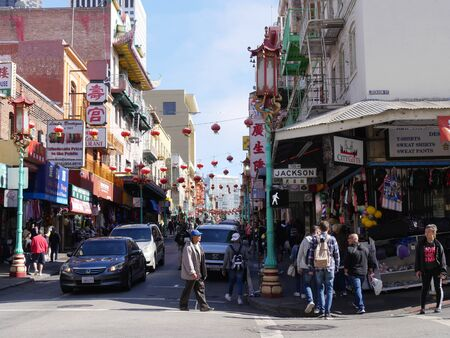 San Francisco, California-July 2018: Busy street in Chinatown, with shoppers walking on the streets.