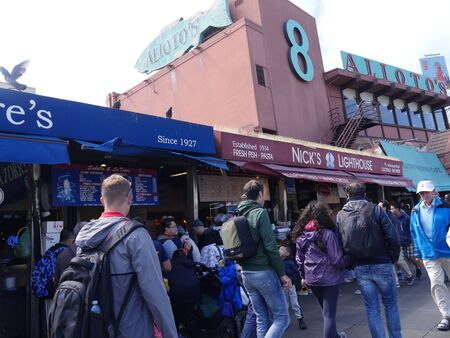 San Francisco, California-July 2018: People walking outside rows of seafood restaurants at the Fisherman's Wharf in San Francisco.