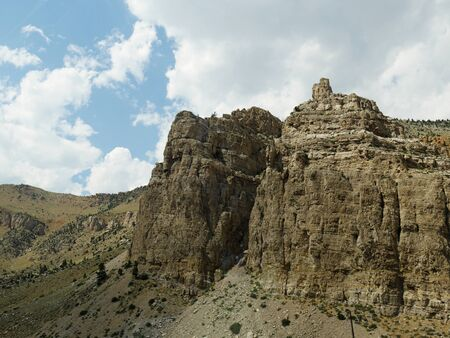Spectacular buttes and geologic formations seen along the road from North Fork Highway in Wyoming.