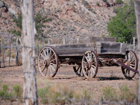Old harvesting machine with rusty wheels displayed along the road at the Grafton ghost town, a town washed away by the Great Flood of 1862, Utah.
