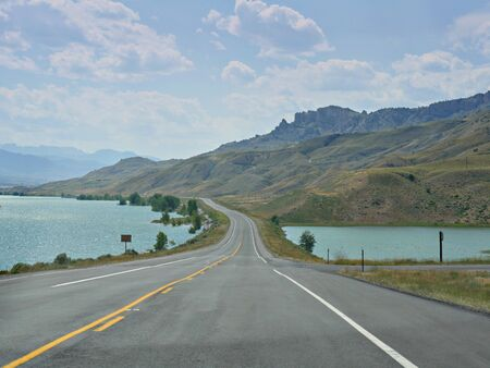 Scenic drive along North Fork Highway with the Buffalo Bill Reservoir and Dam along the road.