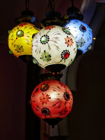 Agra, Uttar Pradesh, India- March 2018: Close up of colorful lantern lights hang from the ceiilng of a restaurant in Agra.