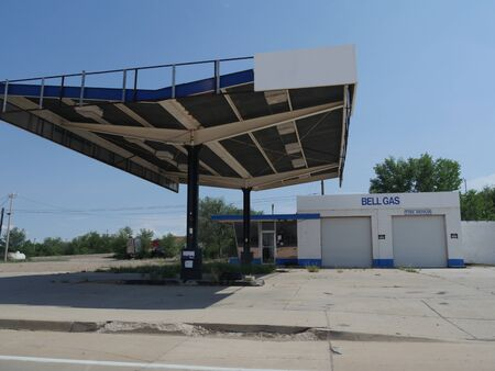 Sta Rosa, New Mexico- August 2018: Former gasoline station and structure, with a For Sale sign in Sta. Rosa.