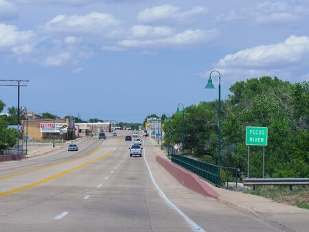 Sta Rosa, New Mexico- August 2018: Wide street shot with Pecos River in Sta Rosa, New Mexico. Stock fotó