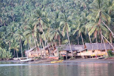 Surigao del Sur, Philippines- August 2014: Fishing village with coconut trees all around in Carrascal, Surigao del Sur.