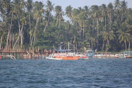 Surigao del Sur, Philippines- August 2014: Boats tied to wooden posts in a fishing village in Surigao del Sur.