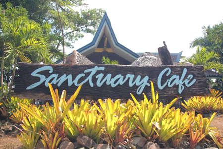 Surigao del Sur, Philippines- August 2014: Wooden sign along the highway at the fish sanctuary in Cantilan, Surigao del Sur.