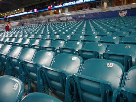 Miami, Florida- December 2018: Medium wide shot of rows of empty seats after a football game at the Hard Rock Stadium in Miami.
