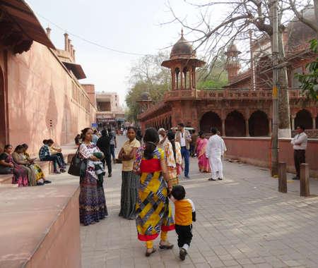 Agra, Uttar Pradesh, India- March 2018: Visitors mill around the Taj Mahal compound, a UNESCO heritage site in India.