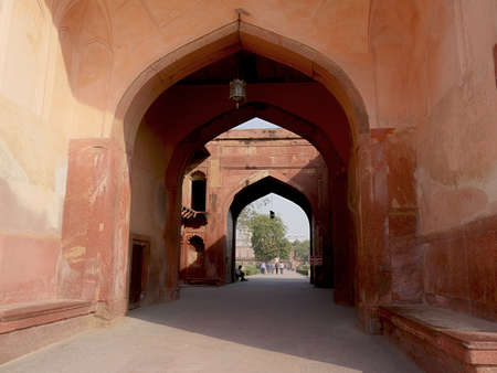 Agra, Uttar Pradesh, India- March 2018: Row of arches inside Agra Fort, a top destination in India.