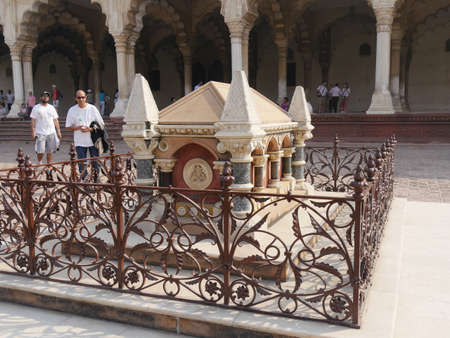 Agra, Uttar Pradesh, India- March 2018: John Russell Colvin's grave at the Agra Fort in India, with two men standing close by.