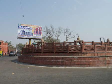 Agra, Uttar Pradesh, India- March 2018: Rotunda with a big billboard advertising at a street in Agra.