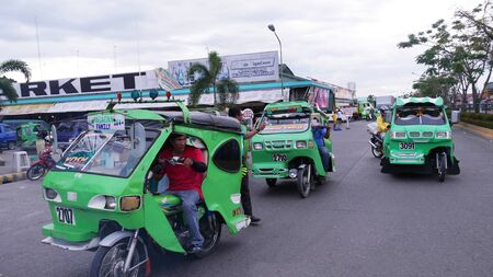 Tagum City, Philippines- March 2016: Tricycles, or improvised motorcycles with side cars are one of the modes of transportation in the southern Philippines. Stockfoto