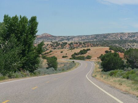 Scenic winding road in Wyoming approaching the Montana state line.