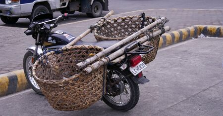 Tagum City, Philippines- March 2016: An improvised motorcycle attached with two big baskets to load with stuff.