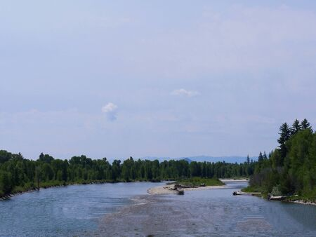 Wide shot of the Snake River flowing just outside Jackson Hole, Wyoming.