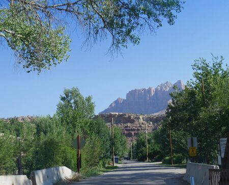 Springvale, Utah- July 2018: Old bridge with road view and the distant mountains of Zion National Park.