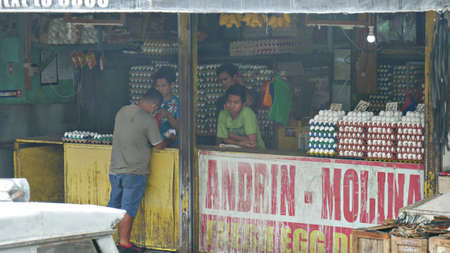 Tagum City, Philippines- March 2016: Front of an egg store with people inside. Redactioneel
