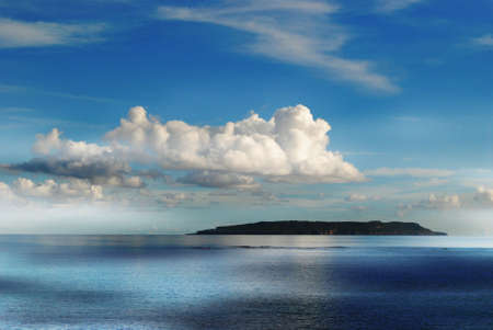 Silhouette of the Goat Island across from Tinian, Northern Mariana Islands.
