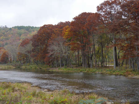 Scenic riverside view at the Beaver's Bend State Park with the leaves of the trees in full autumn colors