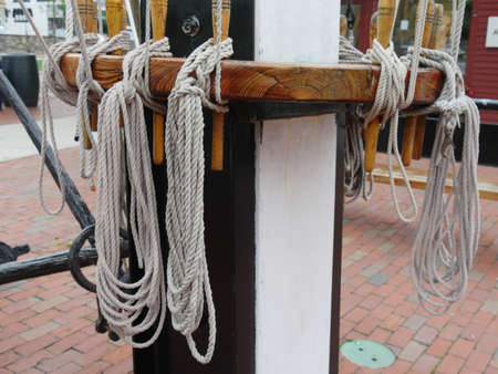 Ropes tied to a post in a yacht club marina Stock Photo