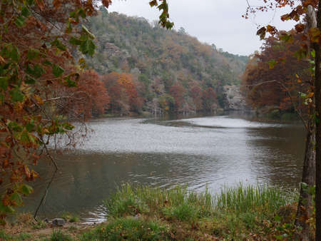 Beautiful view facing Mountain Forks River at the Beavers Bend State Parks in Broken Bow, Oklahoma with colorful trees around Stock Photo