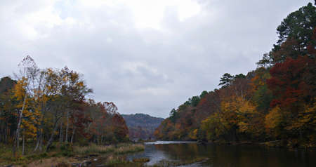 Panoramic view of colorful leaves of the trees along the Mountain Fork River at the Beavers Bend State Park in Broken Bow, Oklahoma