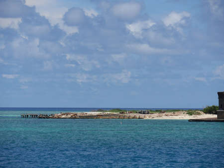 Wide shot of the back beaches of Fort Jefferson surrounded by blue waters, Dry Tortugas National Park. Banco de Imagens