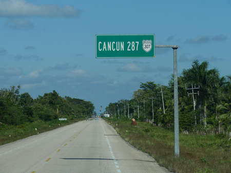 Signs on the road in Costa Maya, Mexico.