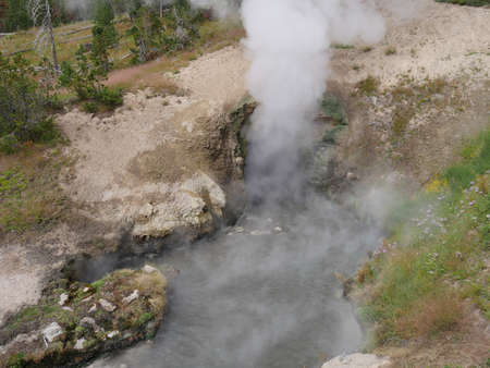 Close cropped shot of the mouth of the Dragon's Mouth spewing out hot steam at Yellowstone National Park.