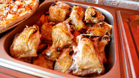 Roasted chicken thighs in a metal tray Banco de Imagens