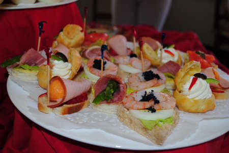 Assortment of seafood appetizers and rolled ham slices