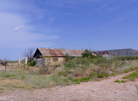 An abandoned house is among the few remaining structures of the ghost town in Montoya, New Mexico.