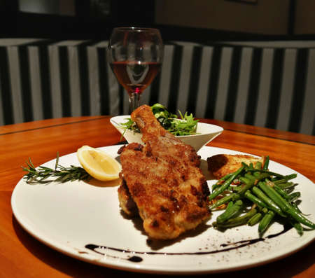 Roasted chicken with green beans and vegetable salad, served with red wine Banco de Imagens