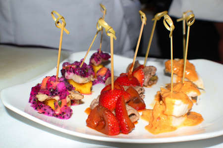 Assortment of eye-catching appetizers in a white plate