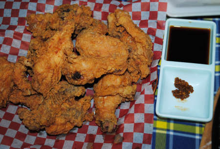 Cispy fried chicken thighs, downward shot, with soysauce and chili dip